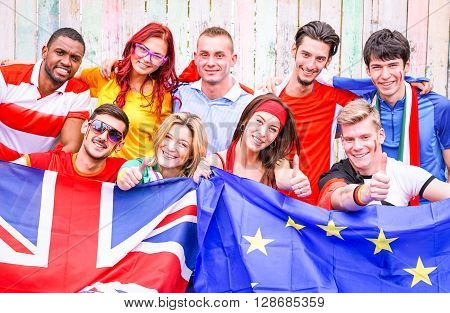 Group of multiracial sport fans supporters of united European countries outside football stadium - Multicultural cheerful friends with national soccer team color joyful moment - Togetherness concept