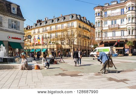 BADEN-BADEN, GERMANY  - MAY 4: A man videotapes in the historic center of Baden-Baden. Baden-Baden is the most visited resort in Germany. Germany, Baden-Baden, May 4, 2016