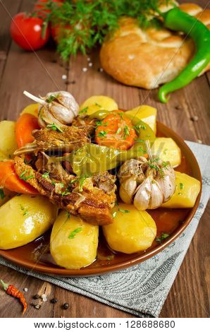 Slow-cooked stew with tender lamb meat potatoes and vegetables. Dumlama - oriental soup with vegetables and lamb