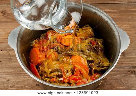 Cooking stew simmered with tender lamb meat potatoes and vegetables. Domlama - Eastern soup with lamb and vegetables