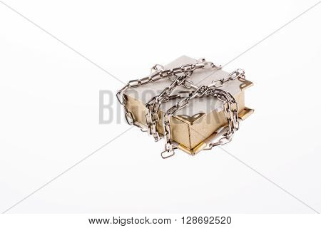 Chained white book plalced on white background