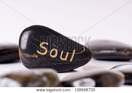 Stone treatment. Black massaging stones isolated on a white background. Hot stones. Balance. Zen like concepts. Basalt stones.