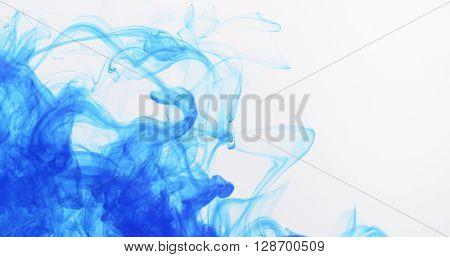 blue ink spreading in water, 4k photo
