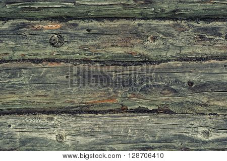 The old distressed wooden blockhouse texture. Photo background.