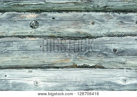 The old greyish wooden blockhouse texture. Background.