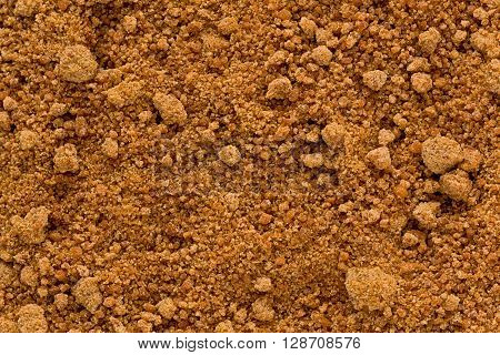Background texture of organic coconut sugar also known as coco sap sugar.