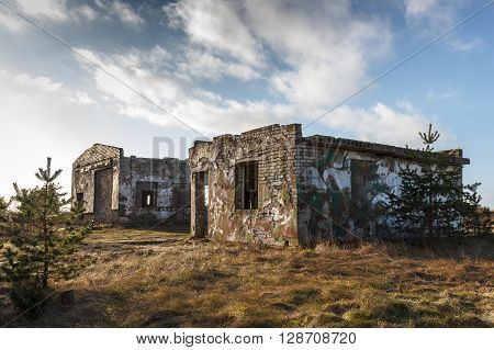 A couple of old ruined stone brick houses in former Soviet Army base