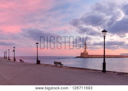 Lighthouse in old harbour of Chania at sunrise, Crete, Greece