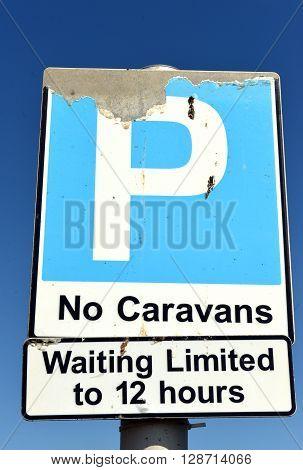 No caravans parking sign p blue sky