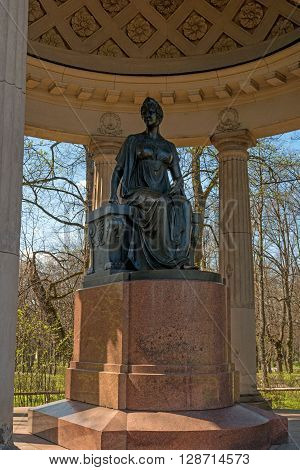 Pavlovsk Russia - May 6 2016: Monument to Empress Maria Feodorovna. Pavilion Rossi. Pedestal - red Finnish granite. The figure of Maria Feodorovna covered with sheet copper dyed black.
