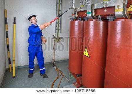 High-voltage detector Electrician Engineer using electrical high voltage tester stick for safety.