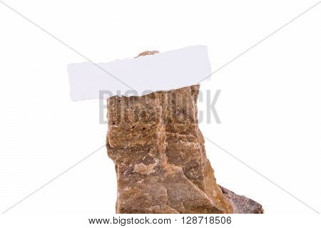 Torn paper on top of the rock