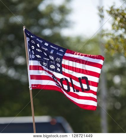 WAUKESHA WI/USA - July 13 2015: A flag protesting corporate spending in American political elections in front of the Waukesha Convention Center during a progressive political protest.