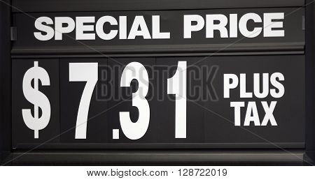 Special price sign with changeable numbers up close.