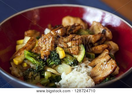 Stir fry with chicken and vegetables up close.