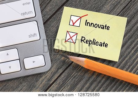 concept of innovation and no replication, with desk background