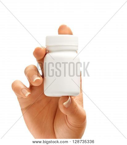Woman's hand shows bottle for pills isolated on white background. Palm up close up. High resolution product.
