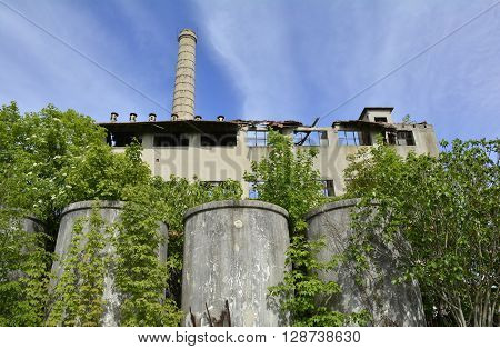 A derelict factory outside Cividale del Friuli Italy. The factory used to produce tannins obtained from chestnut wood (castanea sativa) which was used in the tanning of leather.