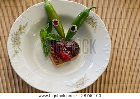 Closeup of some cookies and peppers in the plate