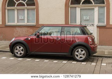 Dark Red Or Maroon Mini Cooper Car