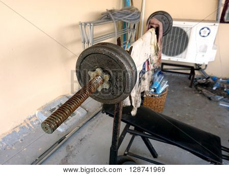 Old gym equipment out of my home was used for weight training