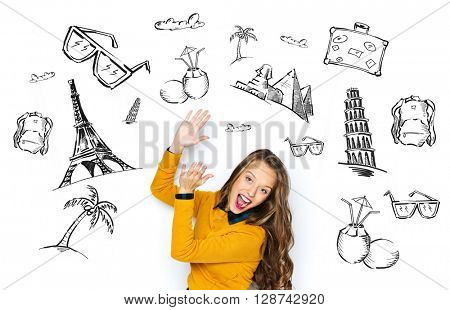 people, tourism, vacation and summer holidays concept - happy young woman or teen girl in casual clothes having fun and applauding over touristic doodles