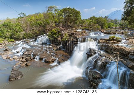 The most popular Tad Hang Waterfall which is on a plateau Bolaven in Laos near the village of Tat Lo.