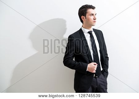 Businessman On White Wall Background