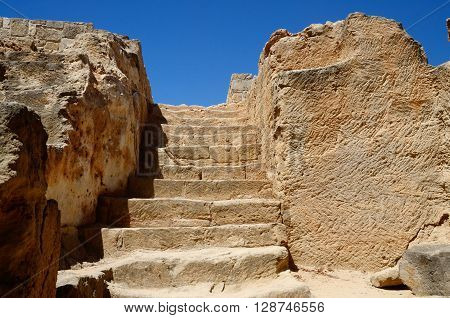 Stairs leading to catacombs of tombs of the Kings famous ancient landmark in Paphos,Cyprus,Europe, unesco heritage