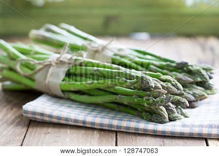 Two bunches of asparagus green in asparagus