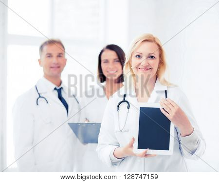 healthcare, medical and technology concept - female doctor with tablet pc