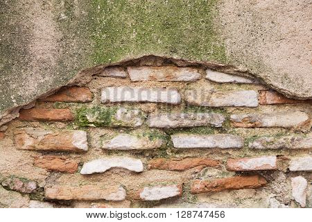 Brick Wall With Stone Covered With Moss