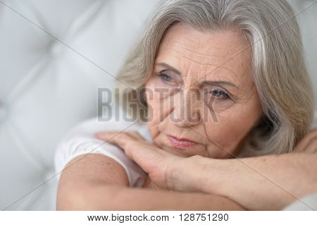 Portrait of a melancholy senior woman close up