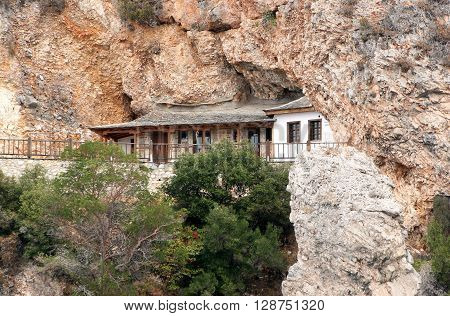 The monastic hermitage located in a cave Athos Mountains. Greece