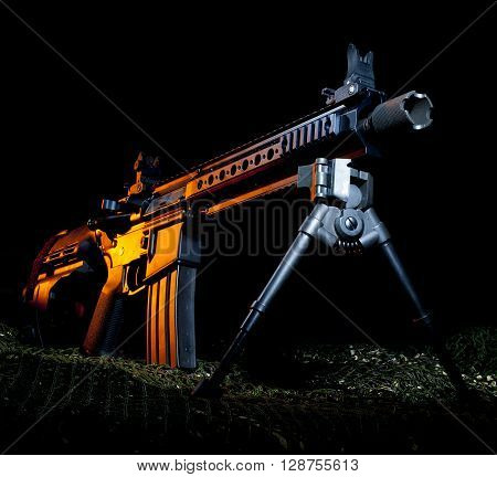 Modern sporting rifle in pistol configuration with a black background