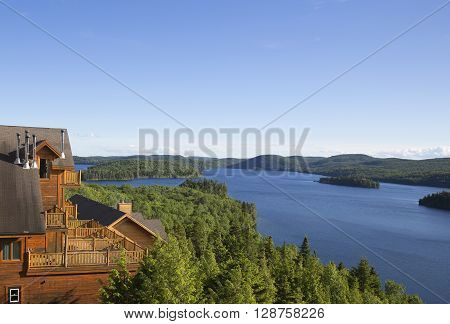 Wide view of natural Sacacomie lake taken from a wooden balcony