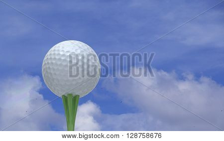 Golf Ball on a tee over blue sky