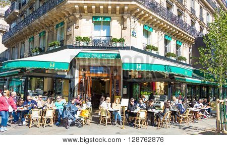 Paris France-May 05 2016: the famous cafe Les deux Magots located in Saint Germain des Pres area of Paris.It has been frequented by Ernest Nemingway Pablo PicassoAlbert Camus James Joyce...