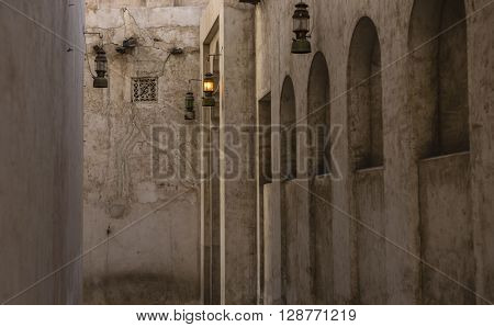 A narrow passage of an old building. Rustic Islamic architectural details.