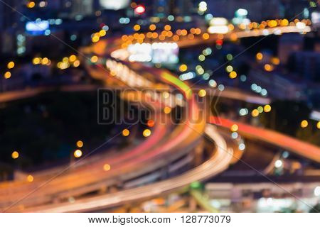 Aerial view, burred bokeh lights highway interchanged night view