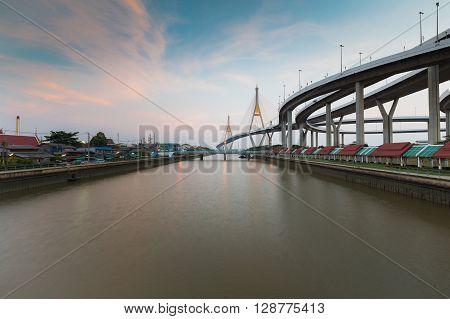 Suspension bridge cross over Bangkok main river with beautiful sky background, Thailand landmark