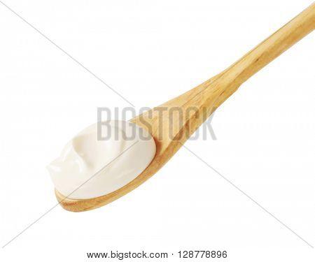 Creme fraiche on a wooden spoon