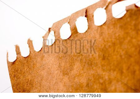 Piece of brown torn paper on a white background