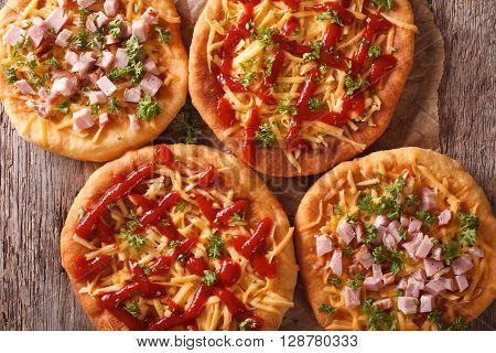 Hungarian Langos With Cheese, Ketchup And Ham Close-up. Horizontal Top View