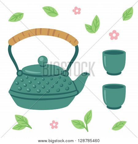Japanese tea set iron tea pot with two cups surronded by tea leaves and flowers.