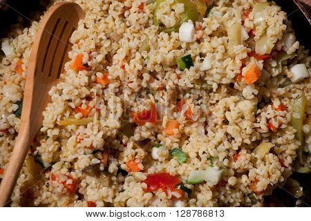 homemade bulgur with vegetables on a table close up