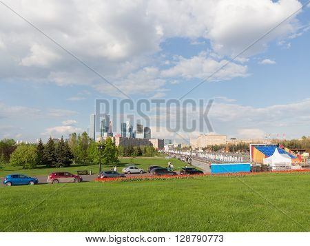 Moscow - May 6 2016: A lot of people are walking in the city of the Victory Park on Kutuzovsky Prospekt on Poklonnaya Hill May 6 2016 Moscow Russia