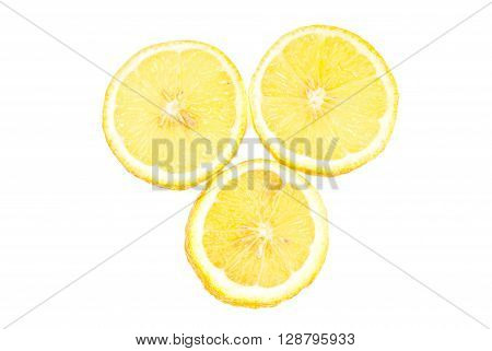 Three lemon  sliced isolated on white background