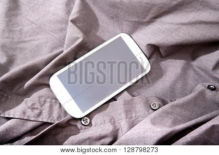 Photo of a Smartphone on some dark cloth.