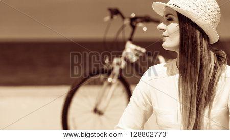 Girl With Bike On Beach.